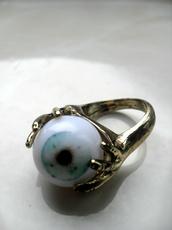 jewels,ring,gold,hands,eye,eye ball,jewllery,jewls,tumblr,jewelry,zombie
