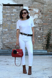 the stylish soul,blogger,t-shirt,shoes,belt,western belt,jeans,red bag,white jeans,animal print,brown boots,white top,double buckle belt,black belt,white t-shirt,handbag,fur keychain,sunglasses,cat eye,spring outfits,boots,bag accessories