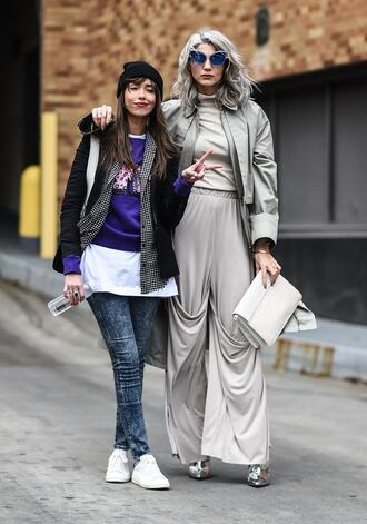 pants nyfw 2017 fashion week 2017 fashion week streetstyle sunglasses blue sunglasses wide-leg pants grey pants jacket grey jacket bomber jacket top grey top grey turtleneck top turtleneck bag white bag sneakers white sneakers jeans denim blue jeans sweater blue sweater black jacket beanie black beanie