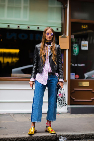 shirt fashion week street style fashion week 2016 fashion week london fashion week 2016 jeans denim blue jeans cropped jeans pink shirt striped shirt black leather jacket leather jacket black jacket jacket gucci gucci princetown gold shoes choker necklace black choker sunglasses