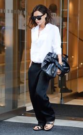 pants,celebrity style,celebrity,black pants,satin,sandals,flat sandals,black sandals,shirt,white shirt,bag,black bag,sunglasses,black sunglasses,victoria beckham