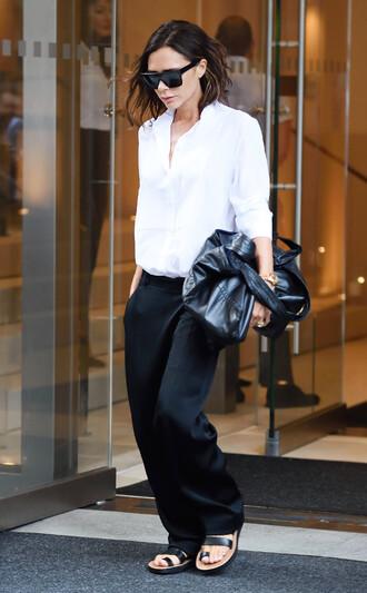 pants celebrity style celebrity black pants satin sandals flat sandals black sandals shirt white shirt bag black bag sunglasses black sunglasses victoria beckham