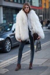 coat,white fur coat,big fur coat,fur coat,white coat,jeans,grey jeans,boots,mid heel boots,brown boots,bag,brown bag,streetstyle,winter outfits,winter coat,winter look,white fur jacket,white oversized coat