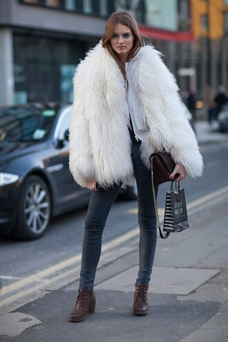 coat white fur coat big fur coat fur coat white coat jeans grey jeans boots mid heel boots brown boots bag brown bag streetstyle winter outfits winter coat