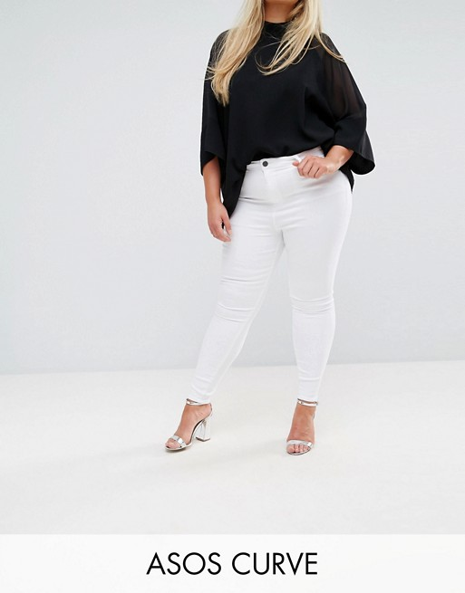 ASOS DESIGN Curve Ridley high waist skinny jeans in optic white at asos.com