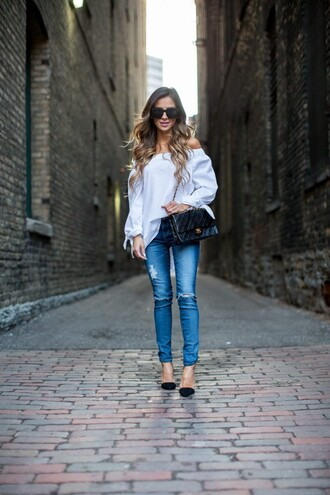 maria vizuete mia mia mine blogger sunglasses blouse ripped jeans shoulder bag black bag black heels white blouse black shoulder bag white off shoulder top top chanel chanel bag blue jeans pumps pointed toe pumps high heel pumps spring outfits long sleeves black pumps puffed sleeves