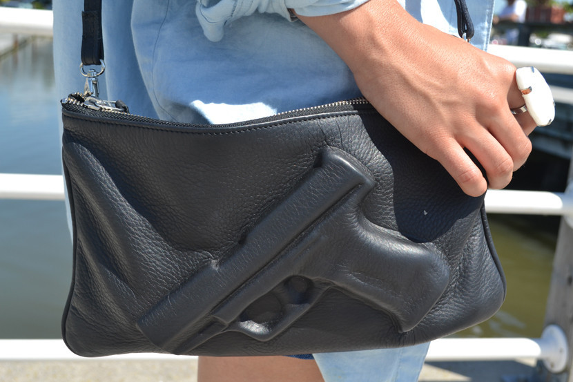 The guardian gun embossed clutch