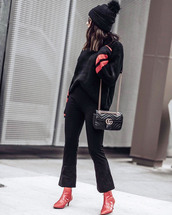 shoes,tumblr,boots,red boot cuff,red boots,ankle boots,pants,black pants,cropped bootcut jeans,sweater,black sweater,beanie,black beanie,pom pom beanie