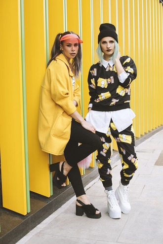 gina vadana vintageena blogger yellow coat bart simpson visor joggers printed sweater platform shoes