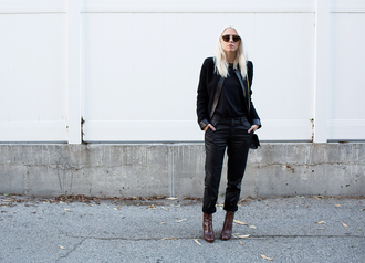 always judging blogger sunglasses winter outfits black jacket boots pants