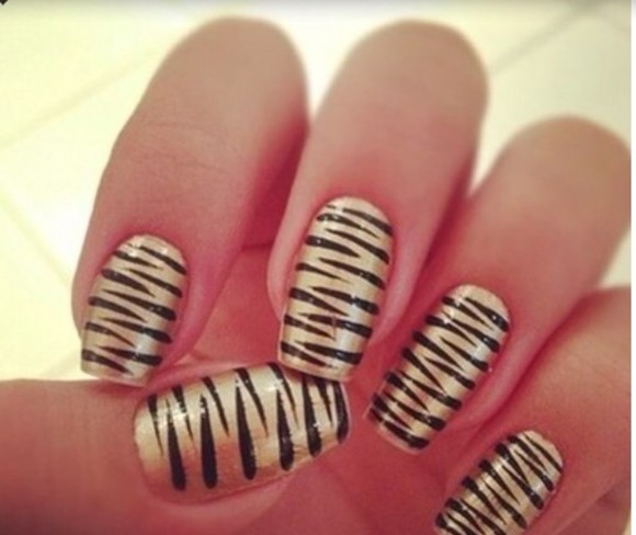animal print black nail polish gold