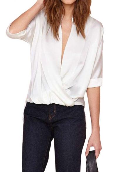 White wrap front 1/2 sleeve dip hem blouse