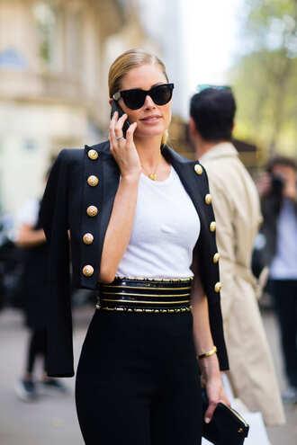 jacket fashion week street style fashion week 2016 fashion week paris fashion week 2016 cropped jacket military style black jacket top white top pants black pants sunglasses black sunglasses doutzen kroes