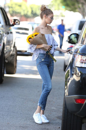 sunglasses,top,leggings,jeans,shoes,striped off shoulder top,blue off shoulder top,sneakers,white sneakers,low top sneakers,cuffed jeans,blue jeans,spring outfits,gigi hadid,celebrity style,celebrity,model,model off-duty,bun,off the shoulder,off the shoulder top,flowers