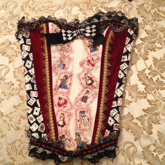 50% off  Tops - Alice in wonderland corset from Gaby's closet on Poshmark