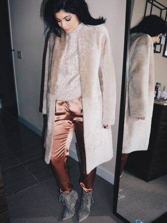 pants kylie jenner fashion week 2016 instagram pointed boots grey boots suede shoes silk dusty pink fur coat beige sweater winter outfits sweater weather beige coat ny fashion week 2016 jacket prom satin shoes lace up heels suede suede boots ankle boots