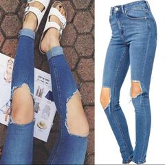 High waisted slashed knee blue skinny jeans