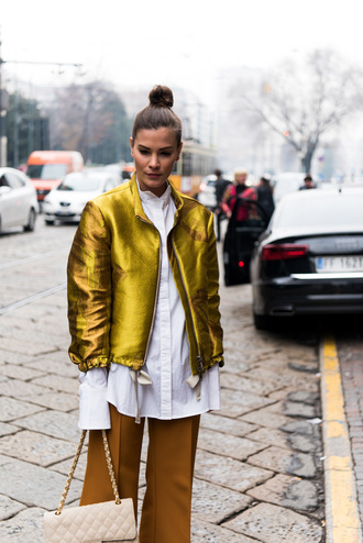jacket tumblr gold gold jacket metallic metallic jacket shirt white shirt pants mustard wide-leg pants hair bun bag white bag quilted bag