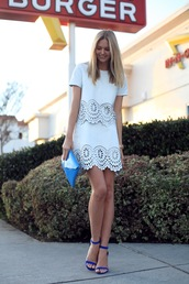 tuula,t-shirt,skirt,bag,shoes,jewels,patent leather bag,eyelet detail,mini skirt,white skirt,white top,short sleeve,blue clutch,sandals,sandal heels,high heel sandals,blue sandals,eyelet top,eyelet skirt,patent bag