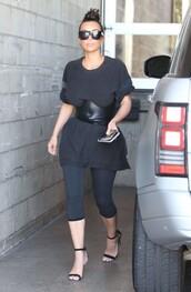 leggings,kim kardashian,shoes,sandal heels,belt,sunglasses,phone,hair bun,t-shirt,top knot bun
