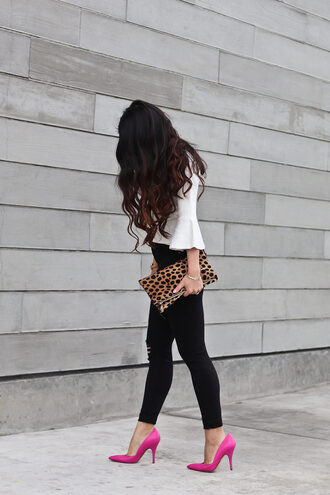 stylish petite blogger sweater jeans coat shoes bag jewels make-up bell sleeves black jeans animal print bag clutch blouse black skinny jeans skinny jeans pouch printed pouch leopard print white blouse three-quarter sleeves pumps pointed toe pumps high heel pumps pink shoes pink heels long hair spring outfits