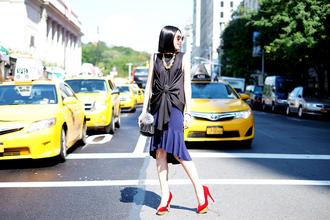 olivia lazuardy blogger top bag sunglasses draped skirt red heels jewels