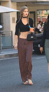 top,choker necklace,crop tops,pants,wide-leg pants,stripes,striped pants,gigi hadid,braid,hairstyles,model off-duty,celebrity style,jewels,model,gigi hadid style,necklace,black choker,black velvet choker