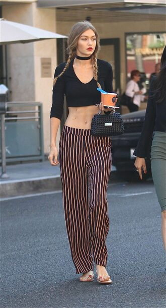 top choker necklace crop tops pants wide-leg pants stripes striped pants gigi hadid braid hairstyles model off-duty celebrity style jewels model gigi hadid style necklace black choker black velvet choker