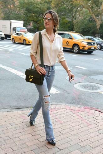 jeans blouse streetstyle fashion week alessandra ambrosio purse sunglasses