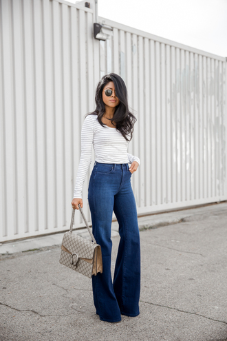 walk in wonderland blogger top jeans bag sunglasses jewels