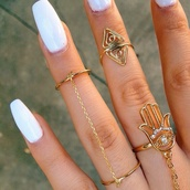 jewels,jewelry,ring,gold ring,knuckle ring,gold midi rings,hand jewelry,gold,hamsa,white nails,chain ring,eye,hanwhure,nail polish acrylics,acrylics,tumblr,pretty,girly,vintage,tumblr girl,tumblr fashion,hippie,indian,accessories,nails,young thug,tiger,middle finger,ring for women,triangle,hand,hair accessory,nail accessories,finger rings,hipster,boho,indie,nail polish,hazzle