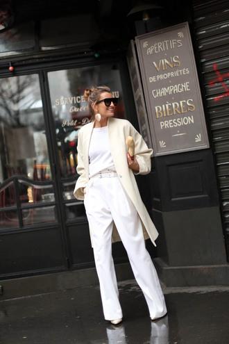 coat white coat earrings sunglasses black sunglasses white top top pants white trousers white pants white