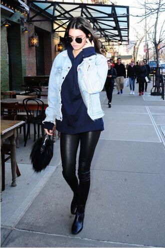 kendall jenner model off-duty streetstyle hoodie denim jacket sunglasses blue sweater leather pants black bag black boots