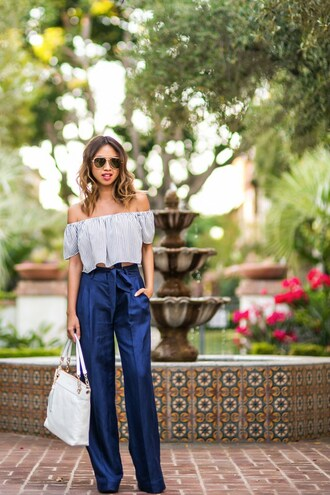 lace and locks blogger top pants sunglasses bag shoes blue off shoulder top blue top crop tops off the shoulder off the shoulder top blue pants high waisted pants wide-leg pants white bag office outfits aviator sunglasses spring outfits striped off shoulder top striped top