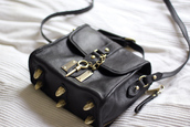 bag,black,leather,hardware,key,lock,crossbody bag,messenger,gold,metal,black bag with gold details