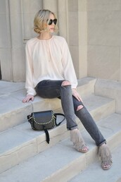 straight a style,blogger,sunglasses,bag,blouse,long sleeves,white blouse,ripped jeans,grey jeans,black bag,grey heels,fringe shoes