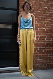 pants,wide-leg pants,silk,yellow,yellow pants,top,blue top,camisole,streetstyle