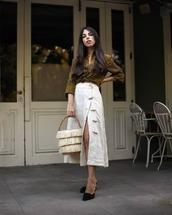 bag,basket bag,handbag,midi skirt,front slit skirt,printed shirt,mules