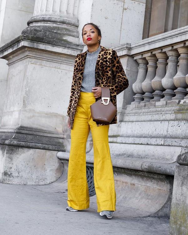 coat animal print coat sneakers yellow pants jumper handbag brown