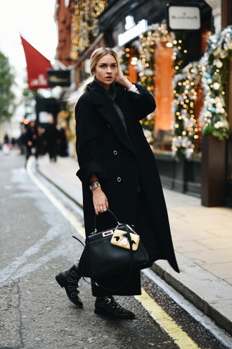 en vogue coop blogger winter coat wool coat long coat black leather bag couture designer bag fendi black coat ankle boots studded shoes printed ankle boots black long coat