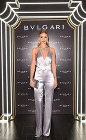 jumpsuit,silver,silk,rosie huntington-whiteley,model,milan fashion week 2016,fashion week 2016,clutch,satin