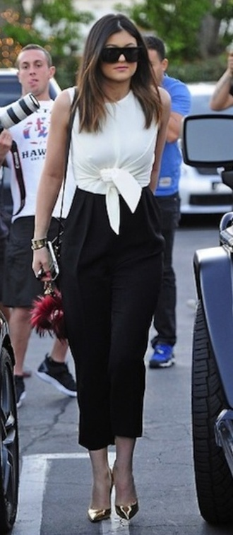 top kylie jenner jumpsuit white top black high waisted pants