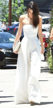 jumpsuit,palazzo jumpsuit,white jumpsuit,clutch,white clutch,bag,white bag,kendall jenner,celebrities in white,celebrity,celebrity style,all white everything,date outfit