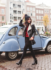 wish wish wish,blogger,shearling jacket,pom pom beanie,red sweater,black boots,beautymanifesto,jacket,sweater,skirt,shoes,bag,hat,black shearling jacket,mini skirt and ankle boots,french girl style