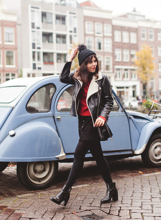 wish wish wish blogger shearling jacket pom pom beanie red sweater black boots beautymanifesto jacket sweater skirt shoes bag hat black shearling jacket mini skirt and ankle boots french girl style