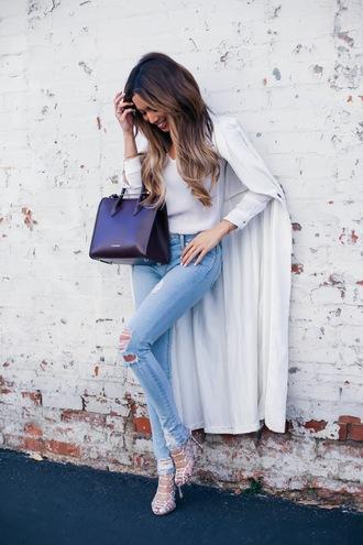 my white t blogger blouse coat white long coat duster coat long coat denim blue jeans ripped jeans skinny jeans bag sandals sandal heels high heel sandals