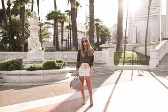 lisa olsson blogger shirt white skirt purse
