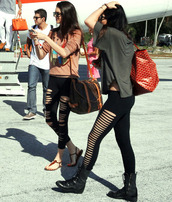 pants,leggings,kylie jenner,kendall jenner,kardashians,keeping up with the kardashians,holes,ripped,ripped leggings,hipster,army green,airport,comfy,clothes,bag,louis vuitton,shirt,shoes