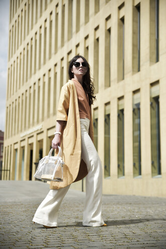 views by laura blogger white pants wide-leg pants plastic handbag