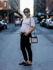 t-shirt,logo tee,white t-shirt,denim,jeans,black jeans,shoes,bag,sunglasses,black and white